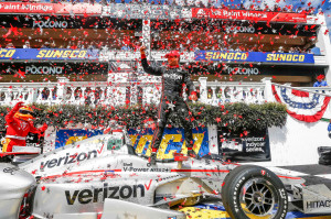 Will Power, driver of the #12 Verizon Team Penske Chevrolet IndyCar V6, celebrates his victory Monday, August 22, 2016, after winning the Verizon IndyCar Series race at Pocono Raceway in Long Pond, Pennsylvania. The victory puts Power in second place in the driver's standings, trailing Team Penske Chevrolet teammate Simon Pagenaud by 20 points (Photo by Phillip Abbott/LAT for Chevy Racing).