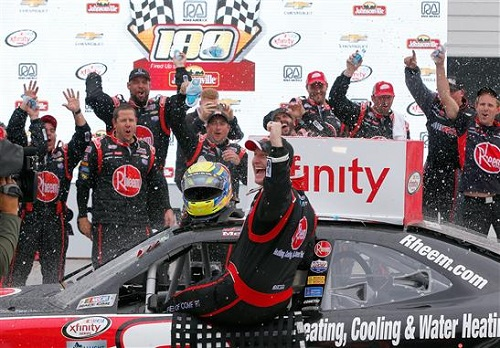 Michael McDowell celebrates in victory lane after winning the Road America 180 on Aug. 26, 2016 (photo courtesy of Getty Images for NASCAR).