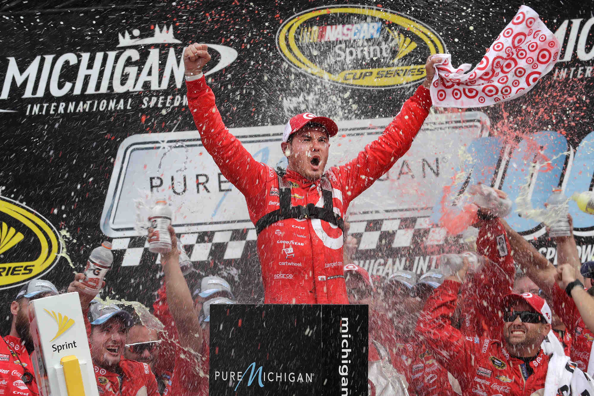 Kyle Larson, driver of the #42 Huggies Chevrolet SS, celebrates his win Sunday, August 28, 2016 in the NASCAR Sprint Cup Race at Michigan International Speedway in Brooklyn, Michigan. This was Larson's 1st career Sprint Cup Series win and the first win, after 99 races, for the Chip Ganassi Racing team. Chase Elliott, driver of the #24 NAPA Auto Parts Chevrolet SS finished second. (Photo by Harold Hinson for Chevy Racing)