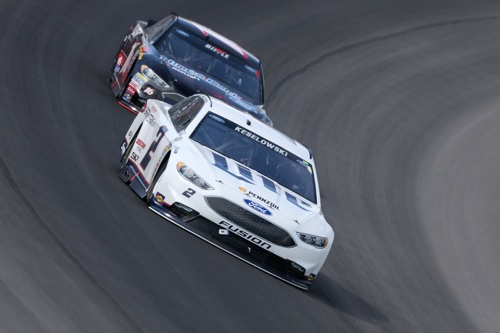 Brad Keselowski (2) leads Greg Biffle during the Pure Michigan 400 at Michigan International Speedway on Aug. 28, 2016 (photo courtesy of Getty Images for NASCAR).