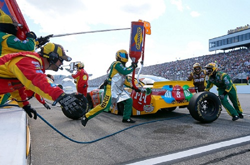 No. 18 Joe Gibbs Racing pit crew of Kyle Busch on pit road at New Hampshire Motor Speedway during the Bad Boy Off Road 300 on Sept. 25, 2016 (photo courtesy of Getty Images for NASCAR).
