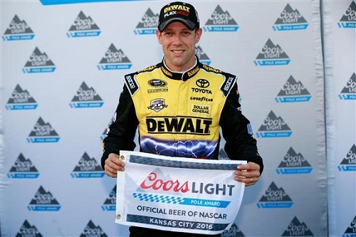 Matt Kenseth celebrates a pole at Kansas Speedway on Oct. 14, 2016 (photo courtesy of Getty Images for NASCAR).