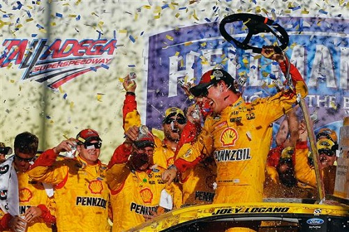 Joey Logano celebrates in victory lane at Talladega Superspeedway after winning the Hellmann's 500 on Oct. 23, 2016 (photo courtesy of Getty Images for NASCAR).