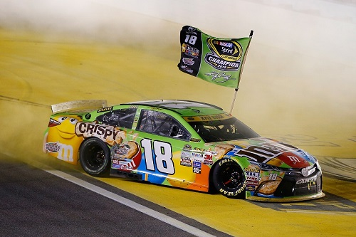 Kyle Busch celebrates his first NASCAR Sprint Cup and the first for Toyota after the 2015 season-finale at Homestead-Miami Speedway last November (photo courtesy of Getty Images for NASCAR).