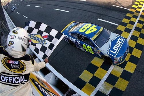 Jimmie Johnson takes the checkered flag in the Goody's Fast Relief 500 at Martinsville Speedway on Oct. 30, 2016 (photo courtesy of Getty Images for NASCAR).