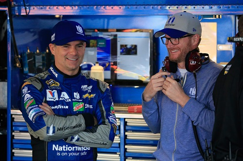 Dale Earnhardt Jr. (right) with Jeff Gordon in the garage at Dover International Speedway on Oct 1, 2016 (photo courtesy of Getty Images for NASCAR).