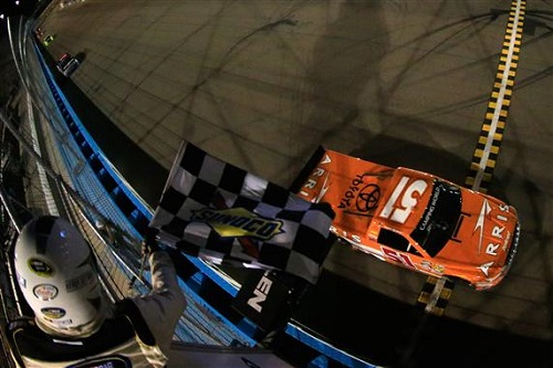 Daniel Suarez takes the checkered flag in the Lucas Oil 150 at Phoenix International Raceway on Nov. 11, 2016 (photo courtesy of Getty Images for NASCAR).