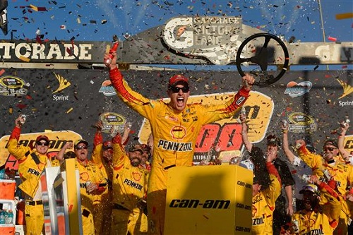 Joey Logano celebrates in victory lane after winning the Can-Am 500 at Phoenix International Raceway on Nov. 13, 2016 (photo courtesy of Getty Images for NASCAR).