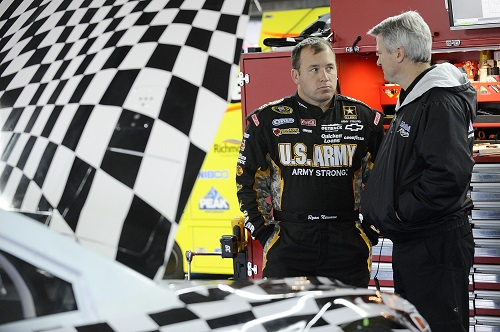Matt Borland (right) with driver Ryan Newman during a test at Charlotte Motor Speedway in December 2012 (photo courtesy of Getty Images for NASCAR).