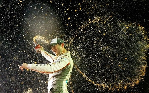 Daniel Suarez celebrates at Homestead-Miami Speedway after winning the Ford EcoBoost 300 and the 2016 Xfinity Series championship on Nov. 19, 2016 (photo courtesy of Getty Images for NASCAR).