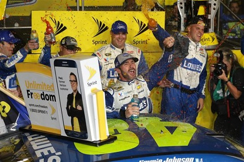 Jimmie Johnson celebrates his seventh Sprint Cup and win of the Ford EcoBoost 400 at Homestead-Miami Speedway on Nov. 20, 2016 (photo courtesy of Getty Images for NASCAR).