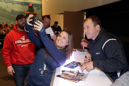 Fan takes a selfie with driver Ryan Newman at the 2015 NASCAR Fan Appreciation Day (photo courtesy of Getty Images for NASCAR).