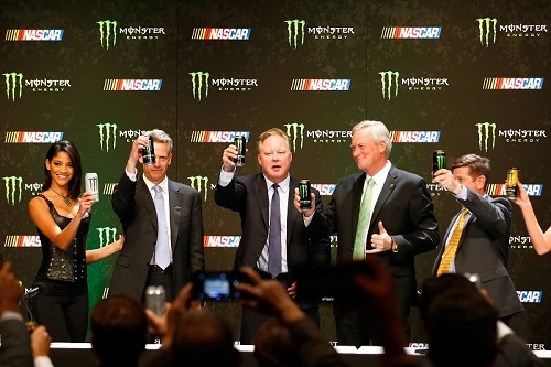 L to R: NASCAR's Steve Phelps and Brian France and Monster Energy's Mark Hall and Mitch Covington during the announcement of Monster's sponsorship of NASCAR's premier series in Las Vegas on Dec. 1, 2017 (photo courtesy of Getty Images for NASCAR).