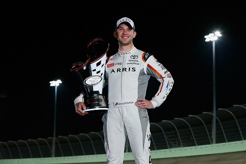 Daniel Suarez with gis 2016 NASCAR Xfinity Series championship trophy at Homestead-Miami Speedway (photo courtesy of Getty Images for NASCAR).
