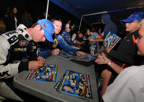 Chase Briscoe signs autographs for fans in 2013 (photo courtesy if Getty Images for NASCAR).
