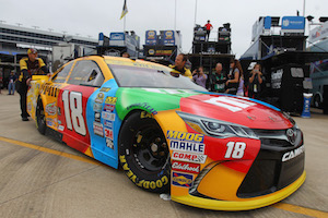 The No. 18 Joe Gibbs Racing Toyota team pushes its car through the garage (photo courtesy of Getty Images for NASCAR)