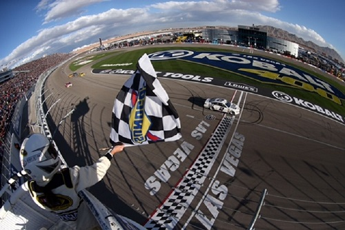 Brad Keselowski takes the checkered flag in the Kobalt Tools 400 at Las Vegas Motor Speedway in March 2016 (photo courtesy of Getty Images for NASCAR).