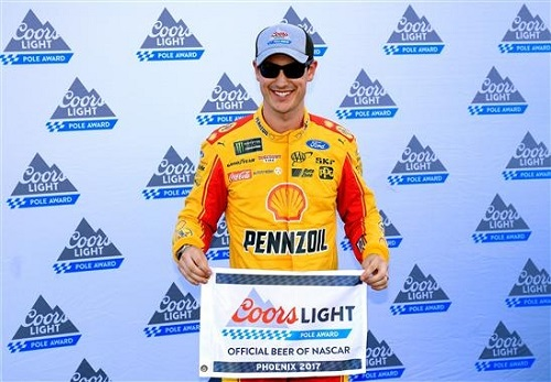 Joey Logano celebrates a pole at Phoenix International Raceway on March 17, 2017 (photo courtesy of Getty Images for NASCAR).
