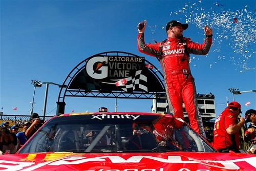Justin Allgaier celebrates in victory lane after winning the DC Solar 200 at Phoenix International Raceway on March 18, 2017 (photo courtesy of Getty Images for NASCAR).