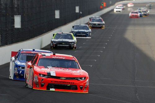 Justin Allgaier (7) leads a pack of cars at Indianapolis Motor Speedway in July 2016 (photo courtesy of Getty Images for NASCAR).