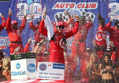 Kyle Larson celebrates in victory lane at Auto Club Speedway after winning the Auto Club 400 on March 26, 2017 (photo courtesy of Getty Images for NASCAR).
