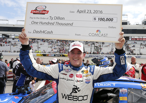 Ty Dillon claims a Dash 4 Cash bonus at Phoenix International Raceway in April 2016 (photo courtesy of Getty Images for NASCAR).
