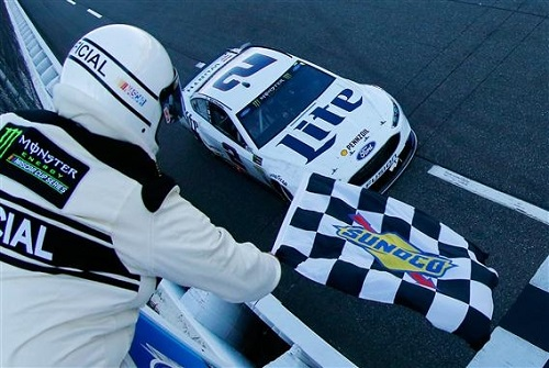 Brad Keselowski takes the checkered flag in the STP 500 at Martinsville Speedway on April 2, 2017 (photo courtesy of Getty Images for NASCAR).
