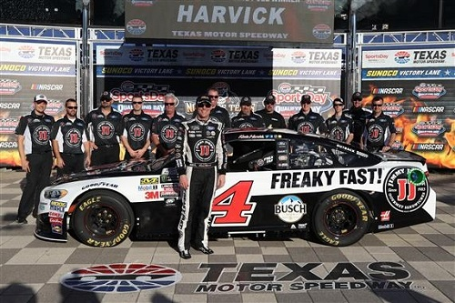 Kevin Harvick and his No. 4 Stewart-Haas Racing Ford team celebrate winning the pole for the O'Reilly Auto Parts 500 at Texas Motor Speedway on April 7, 2017 (photo courtesy of Getty Images for NASCAR).