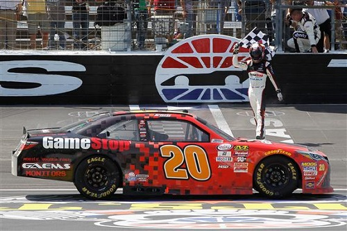 Erik Jones takes the checkered flag in the My Bariatric Solutions 300 at Texas Motor Speedway on April 8, 2017