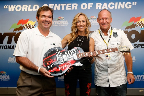 Sam Bass (right) with singer Sheryl Crow and Daytona International Speedway President Joie Chitwood III at Daytona in 2013 (photo courtesy of Getty Images for NASCAR)