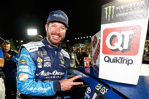 Martin Truex Jr. celebrates winning the GoBowling.com 400 at Kansas Speedway on May 13, 2017 (photo courtesy of Getty Images for NASCAR).