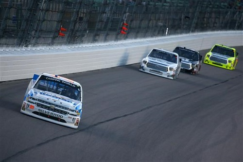 Johnny Sauter leads a group of trucks in the Toyota Tundra 250 at Kansas Speedway on May 12, 2017 (photo courtesy of Getty Images for NASCAR).