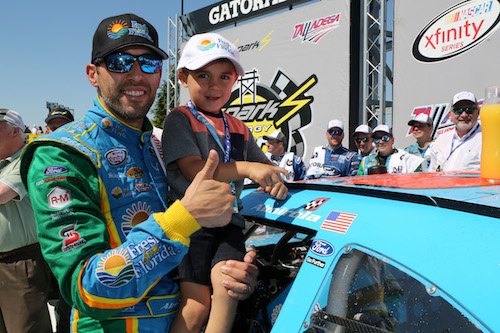 Aric Almirola celebrates winning the NASCAR Xfinity Series race at Talladega Superspeedway on May 6, 2017 (photo courtesy of Getty Images for NASCAR).