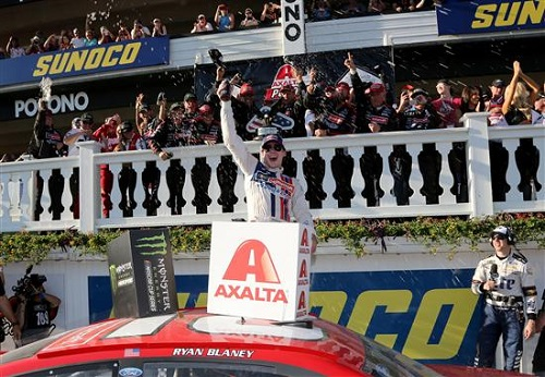 Ryan Blaney celebrates in victory lane at Pocono Raceway after winning the Pocono 400 on June 11, 2017 (photo courtesy of Getty Images for NASCAR).