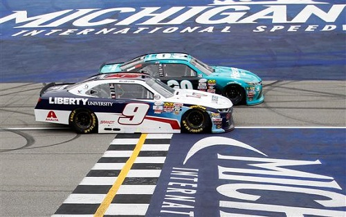 Denny Hamlin (20) edges out William Byron (9) to win the Irish Hills 250 at Michigan International Speedway on June 17 (photo courtesy of Getty Images for NASCAR).