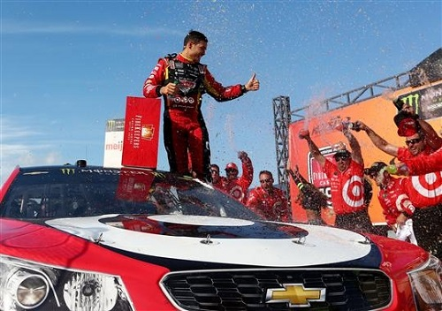 Kyle Larson celebrates in victory lane at Michigan International Speedway after winning the FireKeepers Casino 400 on June 18, 2017 (photo courtesy of Getty Images for NASCAR).
