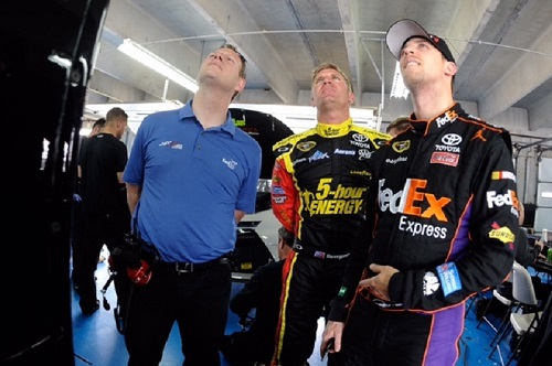L to R: Dave Rogers with Clint Bowyer and Denny Hamlin in the garage area at Charlotte Motor Speedway during a test there in 2015 (photo courtesy of Getty Images for NASCAR).