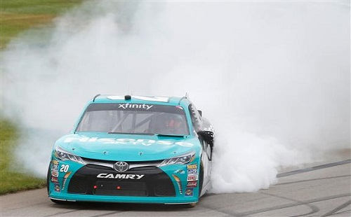 Denny Hamlin performs a celebratory burnout at Michigan International Speedway on June 17 after winning the Irish Hills 250 (photo courtesy of Getty Images for NASCAR).