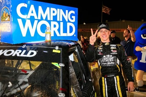 John Hunter Nemechek celebrates at Iowa Speedway after winning the M&Ms 200 on June 23, 2017 (photo courtesy of Getty Images for NASCAR).