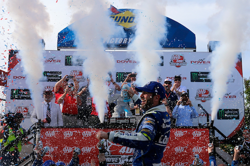 Jimmie Johnson celebrates in victory lane at Dover International Speedway after winning the AAA 400 Drive for Autism on June 4, 2017 (photo courtesy of Getty Images for NASCAR)