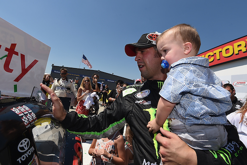 Sam Hornish Jr. celebrates a NASCAR Xfinity Series win at Iowa Speedway in June 2016 (photo courtesy of Getty Images for NASCAR).