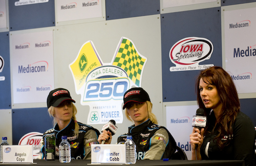 Angela Ruch, along with sister Amber Cope and Jennifer Jo Cobb, at Iowa Speedway in 2011 (photo courtesy of Getty Images for NASCAR).
