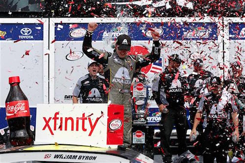 William Byron celebrates in victory lane at Daytona International Speedway after winning the Coca-Cola Firecracker 250 on July 1, 2017 (photo courtesy of Getty Images for NASCAR).