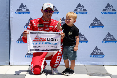Kyle Larson and son Owen celebrate a pole win at Sonoma (Calif.) Raceway in June (photo courtesy of Getty Images for NASCAR).