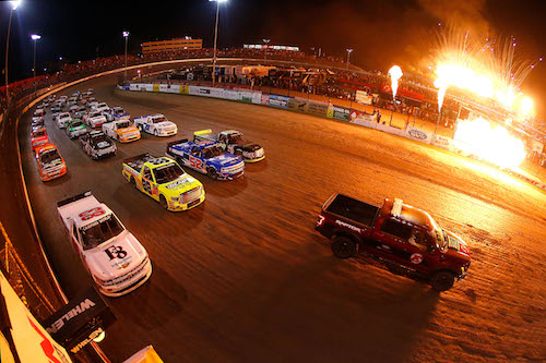 The NASCAR Camping World Truck Series makes a pace lap prior to the start of the Eldora Dirt Derby at Eldora Speedway on July 19, 2017 (photo courtesy of Getty Images for NASCAR).