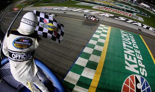 Christopher Bell takes the checkered flag at Kentucky Speedway to win the Buckle Up In Your Truck 225 on July 6, 2017 (photo courtesy of Getty Images for NASCAR).
