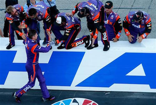 Denny Hamlin celebrates winning the Overton's 301 at New Hampshire Motor Speedway on July 16, 2017 (photo courtesy of Getty Images for NASCAR).