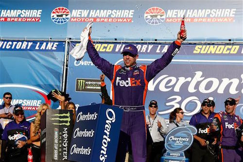 Denny Hamlin celebrates in victory lane after winning the Overton's 301 at New Hampshire Motor Speedway on July 16, 2017 (photo courtesy of Getty Images for NASCAR).