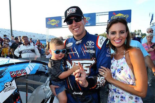 Kyle Busch with son Brexton and wife Samantha at New Hampshire Motor Speedway on July 15, 2017 (photo courtesy of Getty Images for NASCAR)