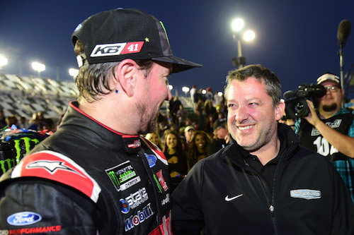 Tony Stewart (right) with Stewart-Haas Racing driver Kurt Busch after the Daytona 500 at Daytona International Speedway in February 2017 (photo courtesy of Getty Images for NASCAR).
